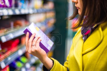 Photo for Young woman shopping in the supermarket - Royalty Free Image