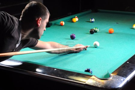 Man playing snooker in the dark club