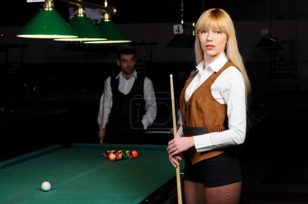Portrait of a young girl playing snooker