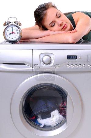 Woman sleeping on a washing machine