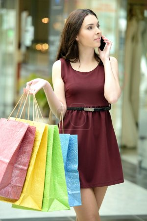 Photo for Young beautiful woman with shopping bags in stores - Royalty Free Image