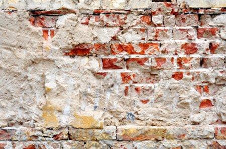 Photo pour Texture fond se compose de vieilles pierres de briques fissurées - image libre de droit