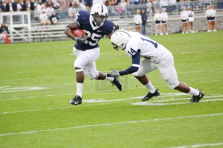 Penn State running back Silas Redd hits the hole