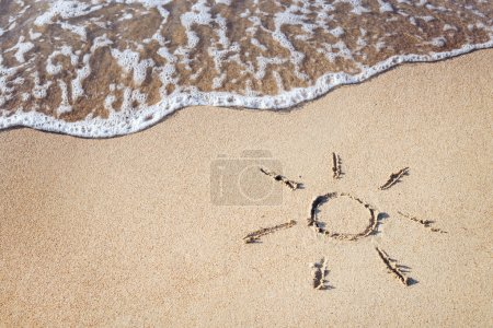 Photo for Drawing sun on the sand - Royalty Free Image