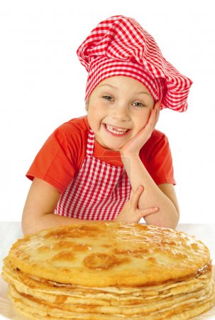Beautiful little girl with pancakes