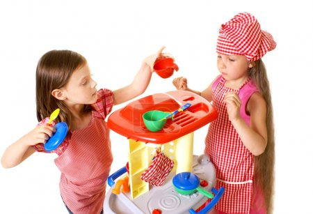 Happy little girls play cooking