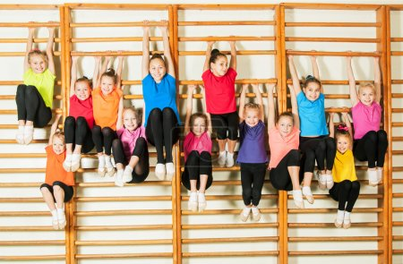 Photo for Group of happy sporty kids in gym - Royalty Free Image
