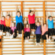 Group of happy sporty kids in gym...