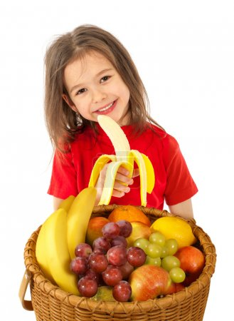 Little girl with basket of fruits