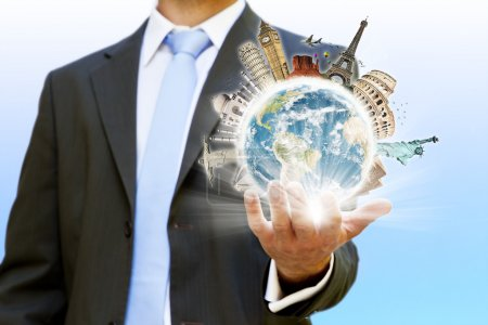 Businessman holding the world in his hand