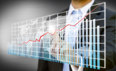 Photo for Businessman creating digital charts made with photoshop CS5 - Royalty Free Image