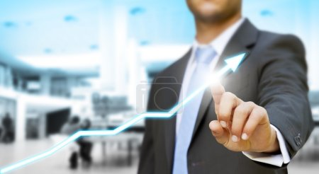 Businessman touching digital graph concept