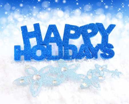 Photo for Inscription of happy holidays is on snow on a festive background - Royalty Free Image