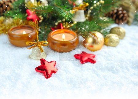 Photo for Christmas composition is with candles on snow - Royalty Free Image