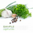 Grains of pepper are with a garlic and greenery of...