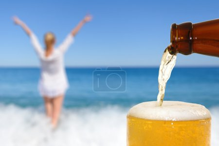 Photo for Beer on the beach background - Royalty Free Image