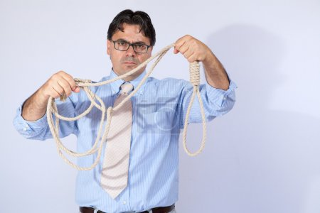 Businessman with rope to the crisis