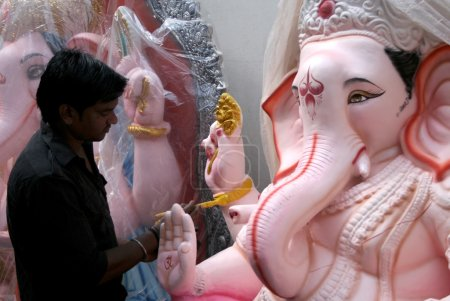 Artists making the Ganesha idol for Hindu festival ganesha chathurthi
