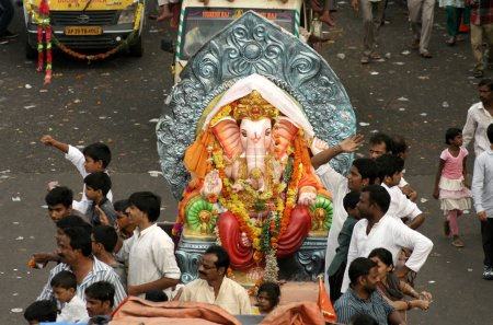 Ganesha idols are being transported for immersion