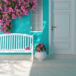 Front view of a wooden white door on a blue house ...