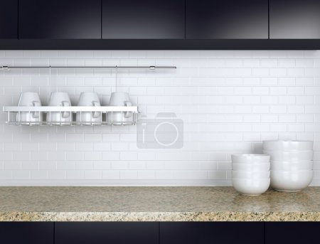 Ceramic kitchenware on the marble worktop. Black a...