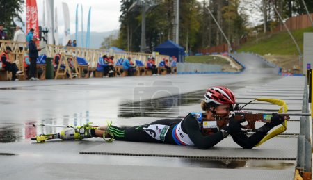 Photo for SOCHI, RUSSIA - SEPTEMBER 21: Ekaterina Yurlova on RBU Championship of Russia in the summer biathlon in Sochi on September 21, 2013. Female prosecution race - Royalty Free Image