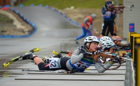 Photo for SOCHI, RUSSIA - SEPTEMBER 21: Anna Nikulina on RBU Championship of Russia in the summer biathlon in Sochi on September 21, 2013. Female prosecution race - Royalty Free Image