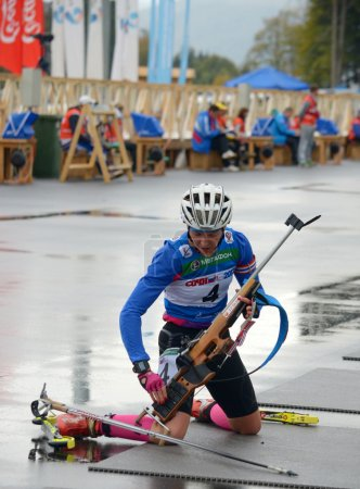 Photo for SOCHI, RUSSIA - SEPTEMBER 21: Ekaterina Glazyrina on RBU Championship of Russia in the summer biathlon in Sochi on September 21, 2013. Female prosecution race - Royalty Free Image