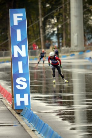 Photo for SOCHI, RUSSIA - SEPTEMBER 21: Finish Line on RBU Championship of Russia in the summer biathlon in Sochi on September 21, 2013. Female prosecution race - Royalty Free Image
