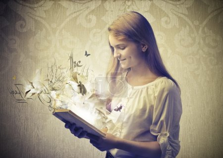 Photo for A baby is reading a fairy tale coming to life. - Royalty Free Image