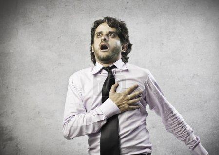 Businessman Blow of Heart