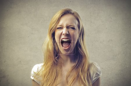 Photo for A beautiful blonde girl is screaming. - Royalty Free Image