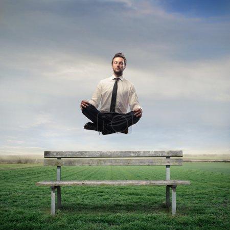 Businessman Levitating on a Bench