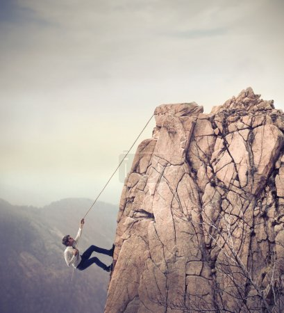 Photo for Office worker climbing the top of a rock - Royalty Free Image