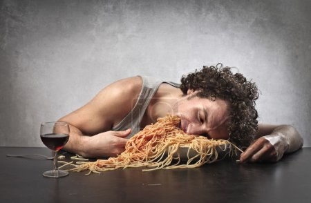 Photo for Man man passed out after having eaten too much - Royalty Free Image
