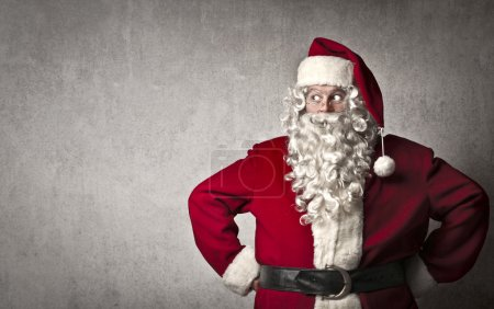 Photo for Santa Claus posing with hands on hips - Royalty Free Image