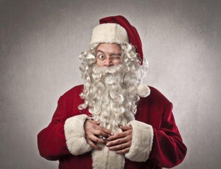 Photo for Winking Santa Claus - Royalty Free Image