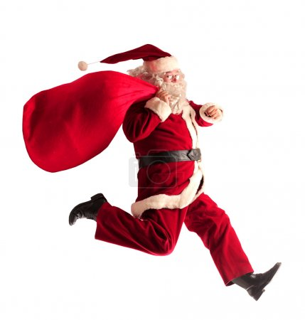 Photo for Running Santa Claus with his sack - Royalty Free Image