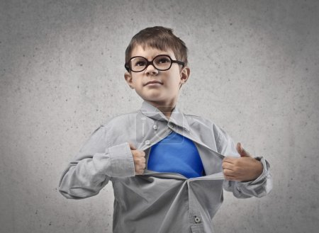 Photo for Child opening his shirt like a superhero - Royalty Free Image