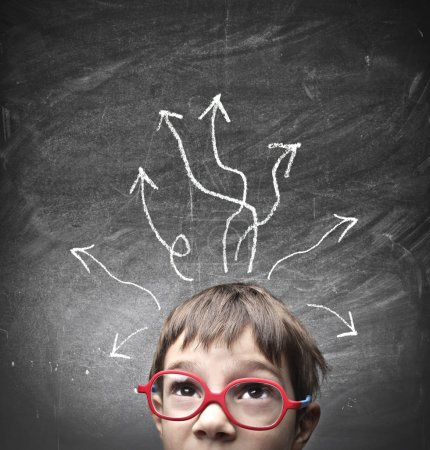 Photo for Child with many arrows drawn on a blackboard behind him - Royalty Free Image