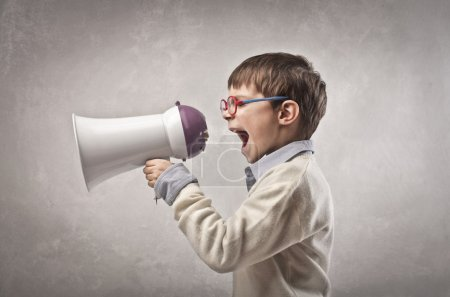 Photo for Child screaming into a megaphone - Royalty Free Image