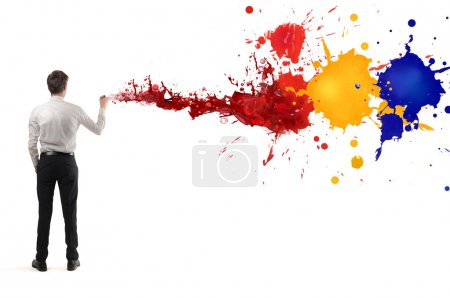 Photo for Young businessman painting on the wall - Royalty Free Image