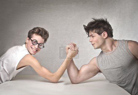 Photo for Young boys playing arm wrestling - Royalty Free Image
