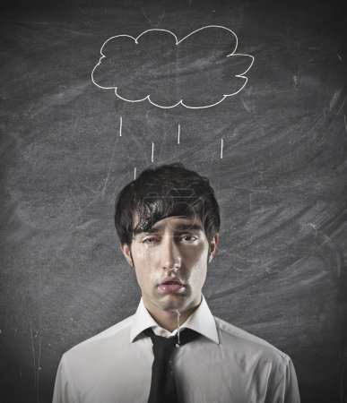 Photo for Soaked businessman with a rain cloud over his head - Royalty Free Image