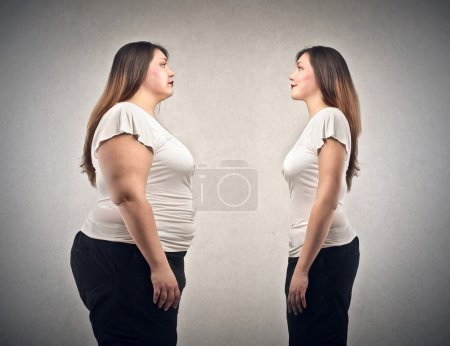 Photo for Fat woman and slim woman on gray backgorund - Royalty Free Image