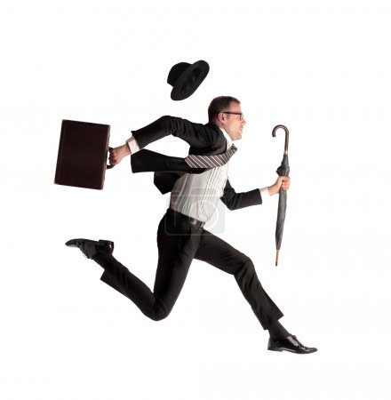Photo for Young businessman running with umbrella and briefcase on white background - Royalty Free Image