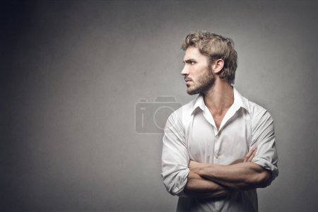 Photo for Profile of a handsome man on gray background - Royalty Free Image