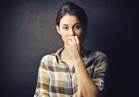 Photo for Woman with a hand in front of her mouth - Royalty Free Image