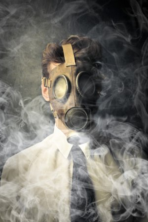 Businessman with a gas mask