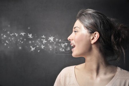 Photo for Drawn stars coming out of woman's mouth - Royalty Free Image